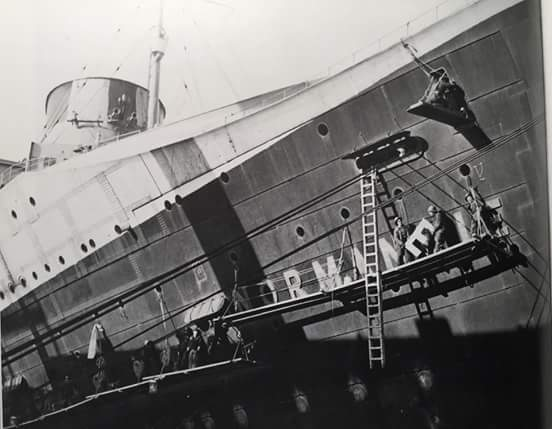 SS Normandie's name is removed early in the conversion process.