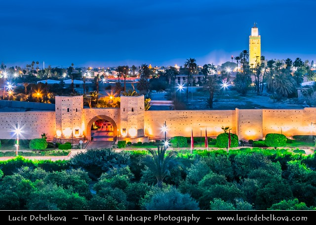 Morocco - Marrakech - UNESCO -  Iconic Minater of Koutoubia Mosque and historical city walls at Dusk - Twilight - Blue Hour - Night