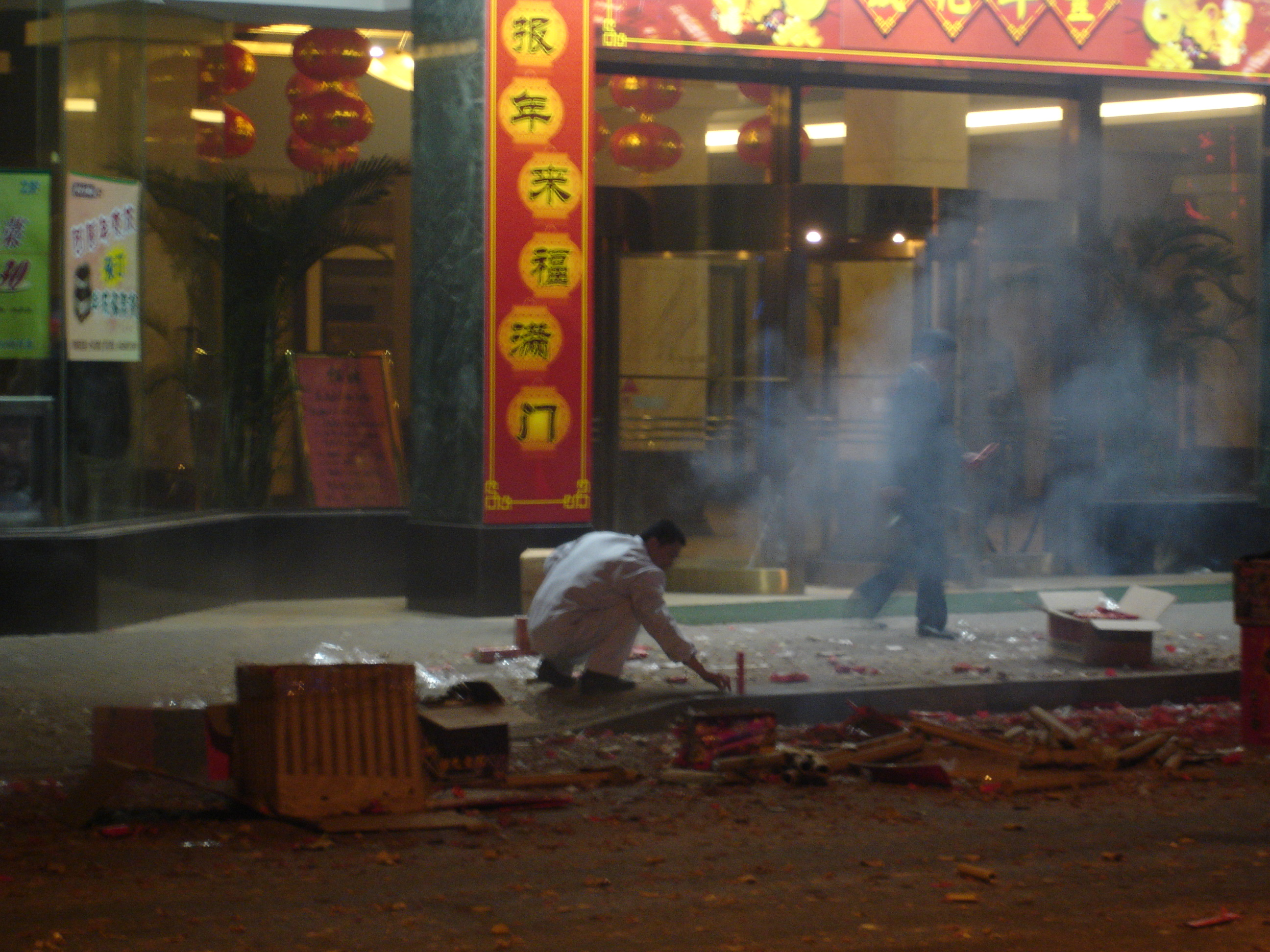 Local man setting off a firework in downtown Shanghai, during Chinese New Year. Photo taken on February 6, 2008,