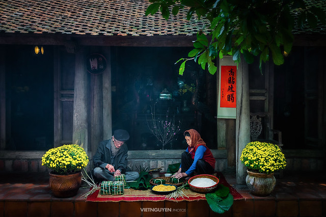 Vietnamese family preparing to make Chung Cake, the Vietnamese lunar new year Tet food outdoor