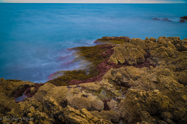 blue sea on red rock