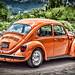 Orange VW Bug (explored) por Michael Guttman