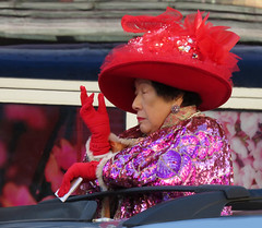Regal lady in a red hat in the Chinese New Year Parade in Vancouver, Canada
