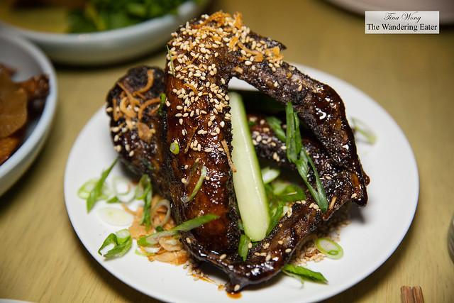 Duck wings, palm sugar glaze, cucumbers, scallions, sesame