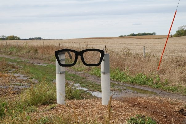A roadside sign in the form of Buddy Holly's glasses, located close to the location where he was killed in a plane crash on February 3, 1959 - The Day the Music Died