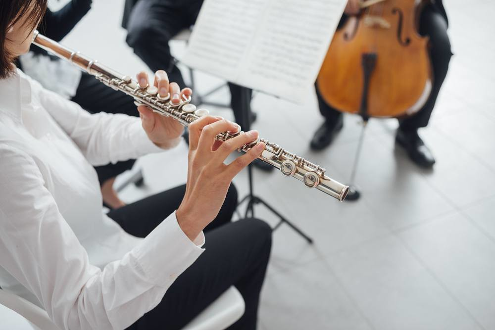 flutist performing in a small ensemble