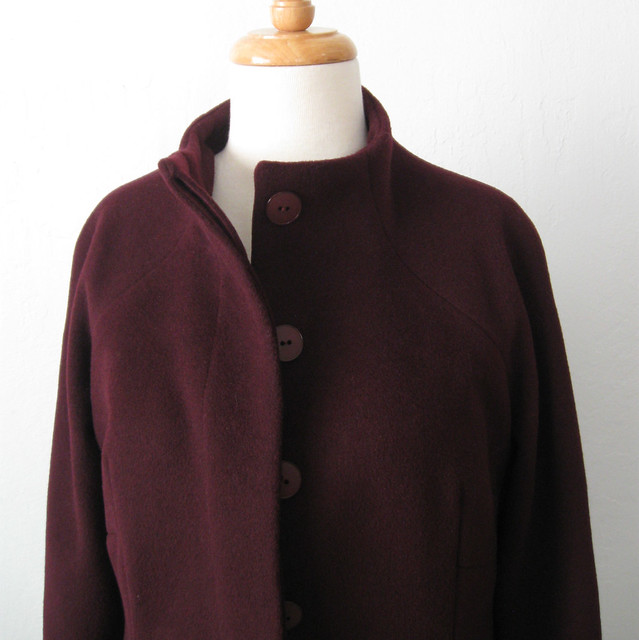 H coat front peek at button placket