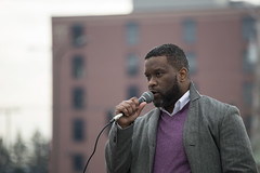 Haitian immigrant speaks at a protest against Trump immigration policies