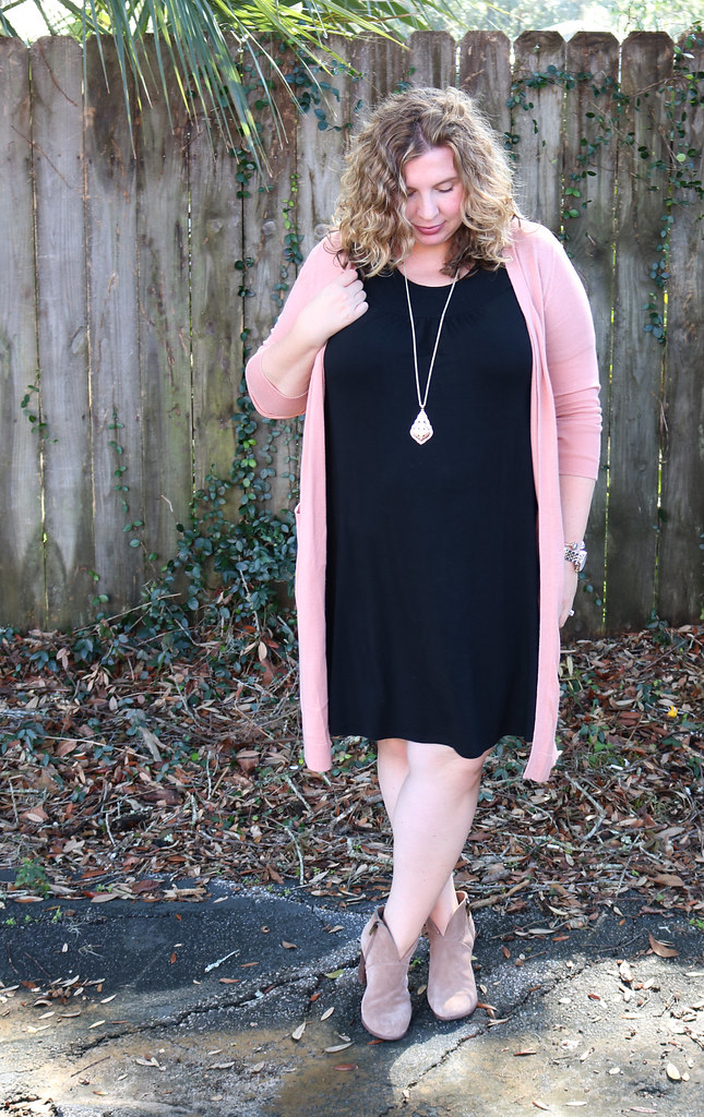 long pink cardigan, black swing dress, mushroom booties 3