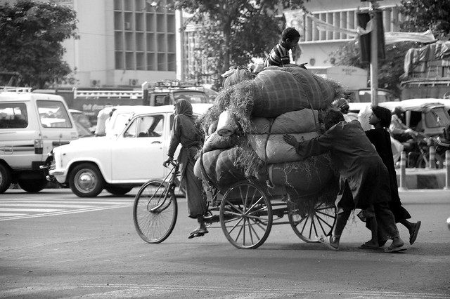 making a living - female rickshaw puller and family - new delhi, india