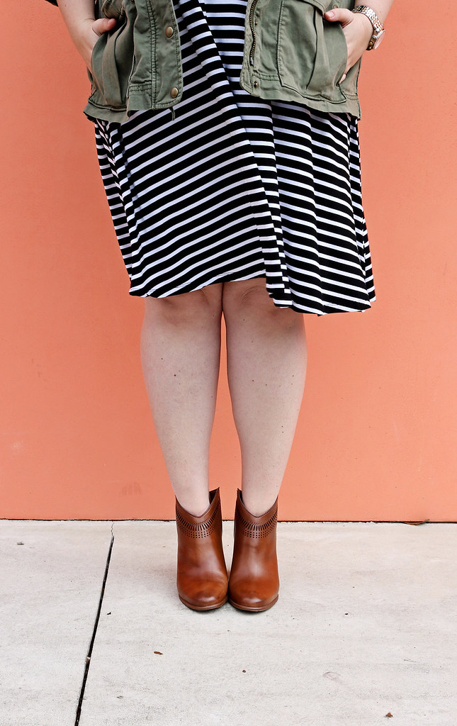 black and white stripe swing dress, olive cargo jacket, cognac booties 1