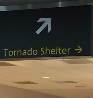Directional arrow to a tornado shelter