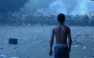 A Boy Confronts Egyptian Military Police South of Tahrir Square - A Potentially Tragic Disparity of Power and Equipment.