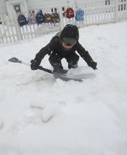 shoveling a chunk of ice