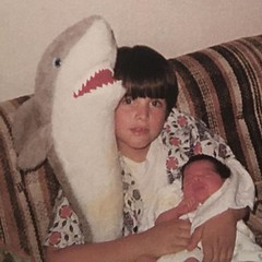Me, Kelly, and a stuffed shark. Because I loved Jaws and my newborn sister?!