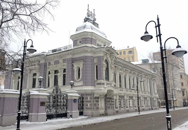Ancient house on Pyatnitskaya street in grey Moscow snow day