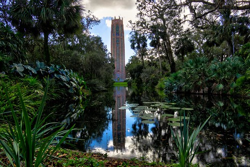 bell tower garden olmsted park history historical trees florida bok refkection nature landscape color view outdor outdoor water clouds sky cat