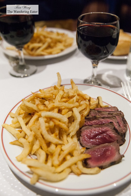 Steak frites (rare) with glasses of Malbec