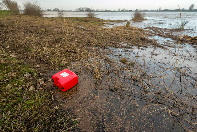 Red plastic jerrycan washed ashore