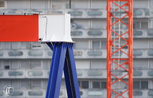 Blue, white, red overhead crane