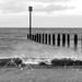 Distant sea posts.