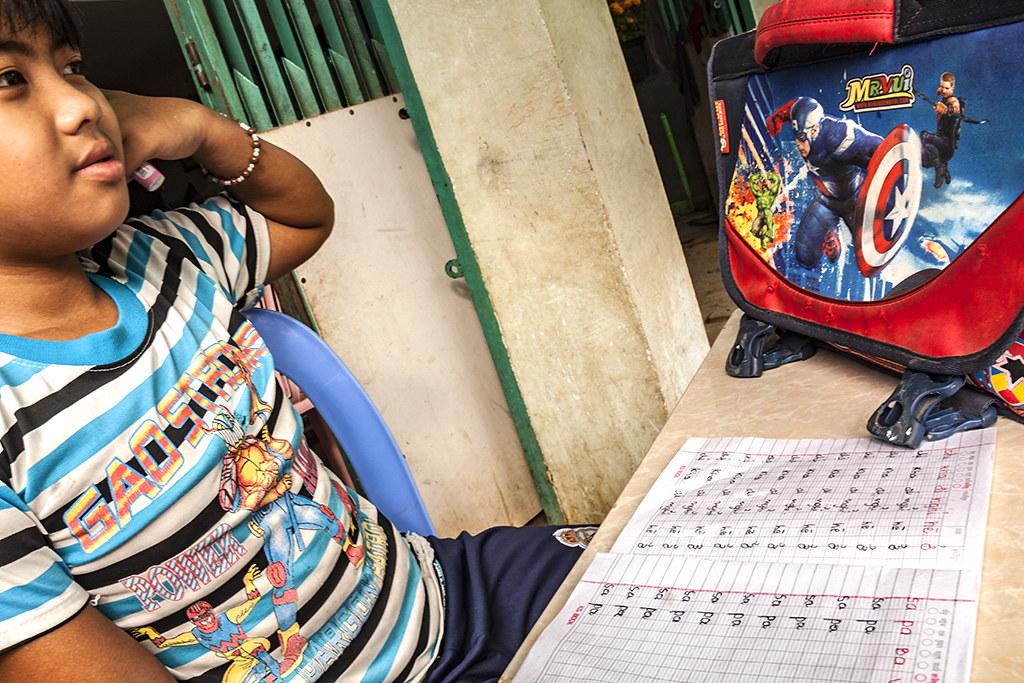 Boy studying Vietnamese in cafe--Akreiy Ksatr