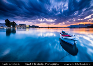 Albania - Butrint National Park - Sunset over laguna with fishing boat