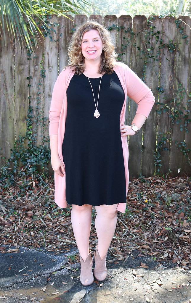 long pink cardigan, black swing dress, mushroom booties 5