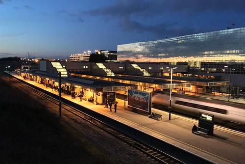 apple iphone se milton keynes station sunset reflected evening railway train sky twilight