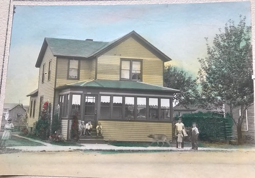 This is our family home on N. Cedar St. My father is the child in the center sitting on the steps. The other children in our neighborhood children. Notice the dog, he is blurry because he was running. I also love that this pho