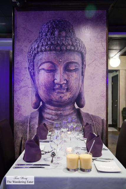 Mango lassis and buddha print on the wall