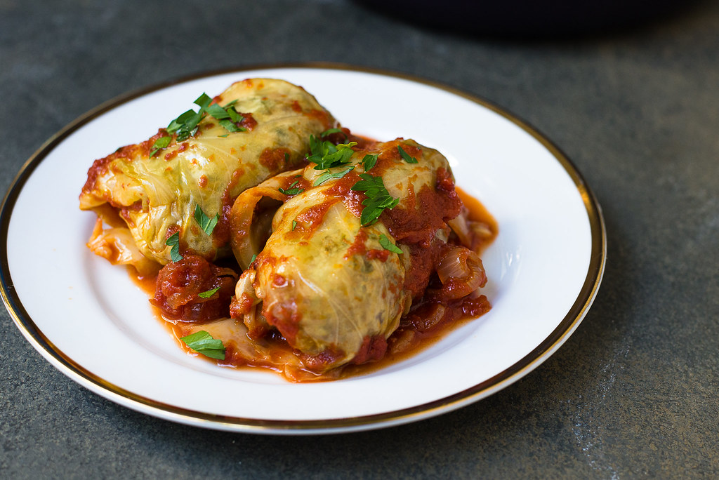 Sweet and Sour Stuffed Cabbage Rolls: Almost classic sweet and sour stuffed cabbage rolls, just like mom made it. The cabbage rolls are filled with meat and rice and sauce sweetened with brown sugar and balanced out with fresh lemon zest and lemon juice.