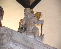 cherub with upturned torch and skull weeps for Sir John Cotton