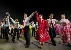 North Korean students dancing to celebrate april 15 the birth anniversary of Kim Il-sung on Kim il Sung square, Pyongan Province, Pyongyang, North Korea