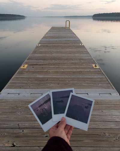 """bookcover"" solitude hand reflection clouds infinity ""photoincontent"" polaroid ""handholdingpictures"" water sunset dock ""jordanlake"" nc"