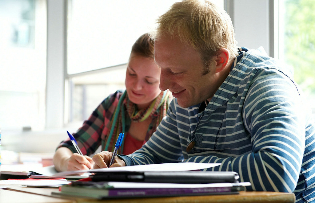 Two students writing in a French class