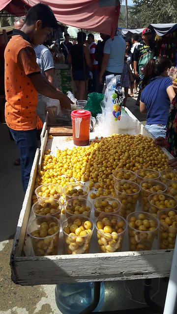 Cart of small yellow fruits in the Bucerias market