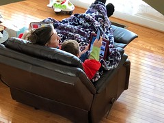 Mommy and the twins relaxing in the front room this morning