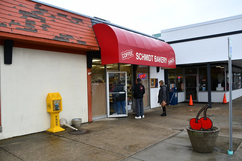 The line of customers at Schmidt Bakery ran out of the door. We were there early, so it was shorter than usual. You can see one of the wooden cherry decorations that were placed all around town for the weekend.