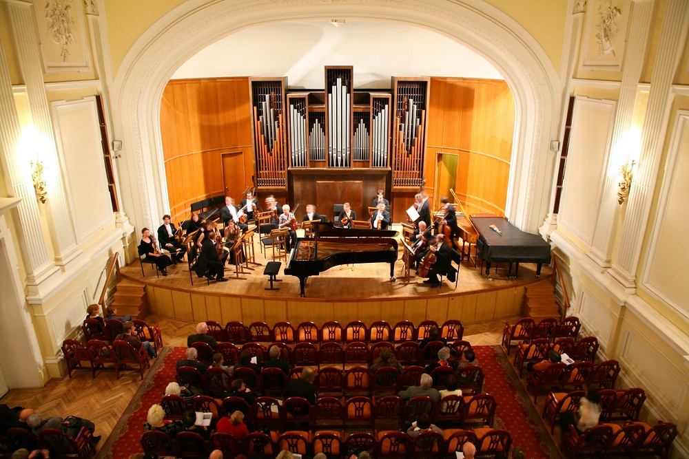 photo of classical musicians performing in a church