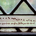 Bar of music on cloister window