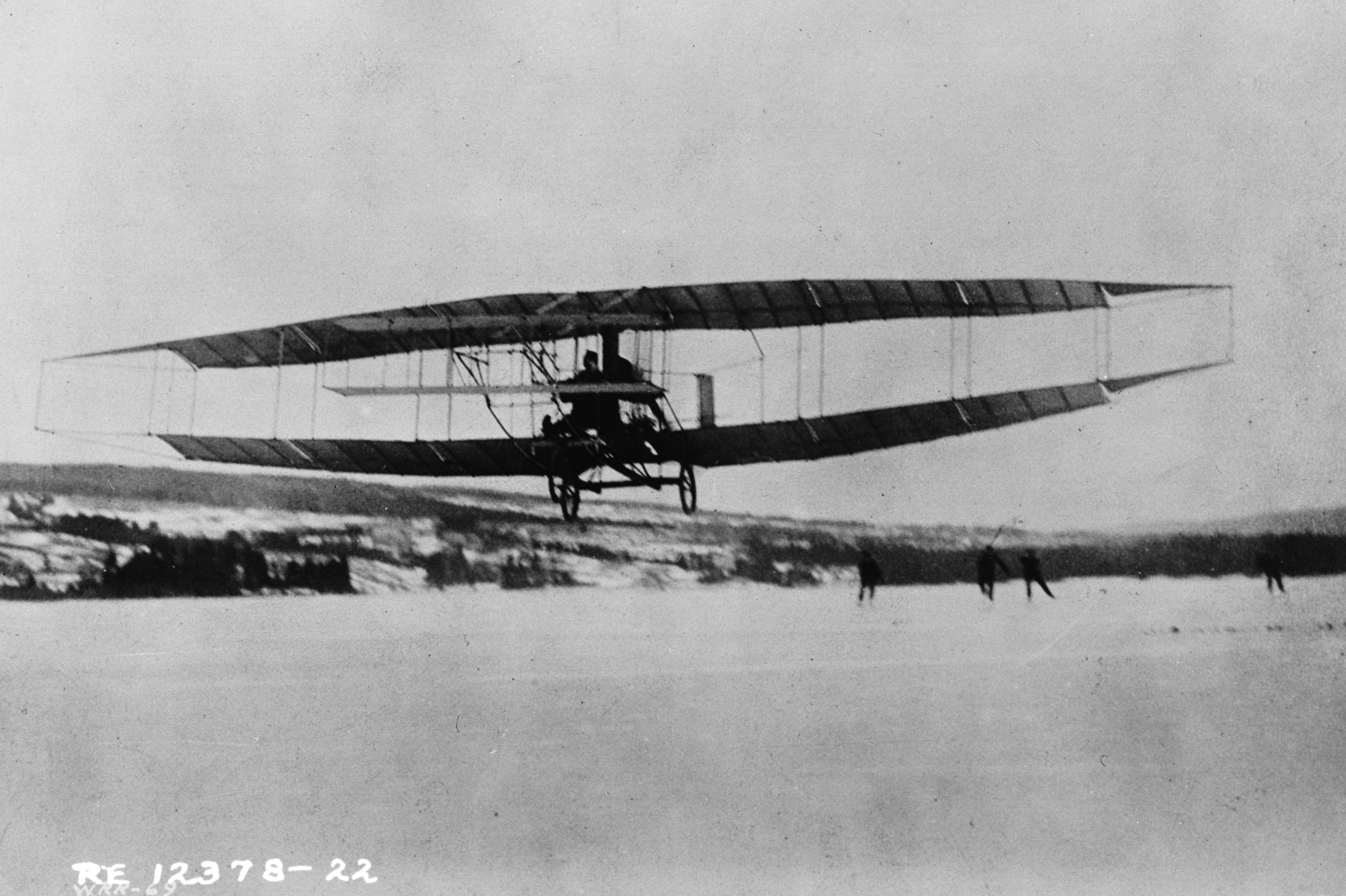The Silver Dart flying above the ice at Baddeck Bay, Nova Scotia, in 1909.