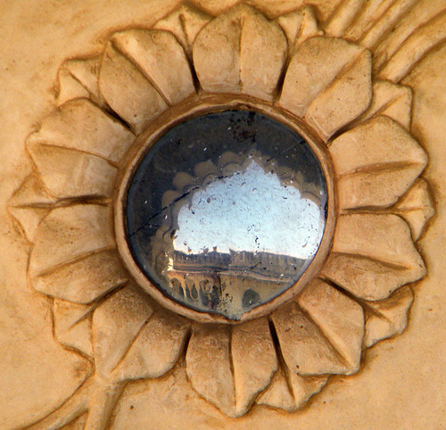 Mirror on the wall of the Amber Fort and Palace near Jaipur in India