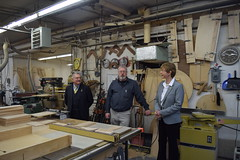 Reps. Simanski and Zawistowski speaking with owner Rick Swenson about his business.