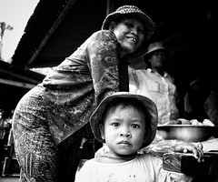 Documenting life in rural Cambodia .....  this was taken at a local shop in a small village ... the little boy was intrigued with the camera as his guardian looked on smiling