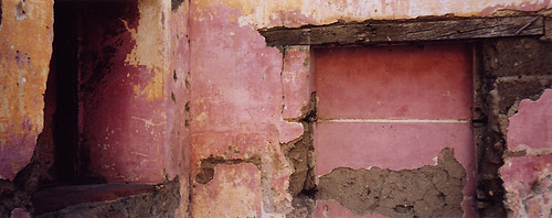 Weathered pink and gold walls in Antigua, Guatemala
