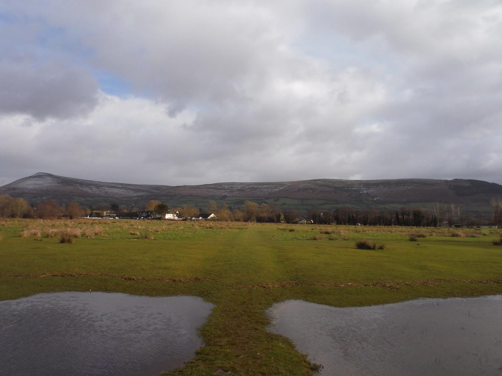 Mynydd Troed and Mynydd Llangorse from flooded field near Llangors SWC Walk 308 - Bwlch Circular (via Mynydd Troed and Llangorse Lake)