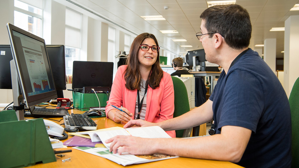 BSc (Hons) Sociology student Vyara Apostolova (left) speaking to a member of staff in an office while on placement at the House of Commons