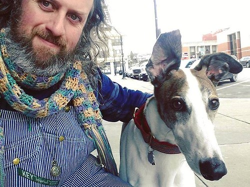 Awaiting a day of adventure! (When The Wife comes out of the cafe with our breakfast.) #Cane #DogsOfInstagram #greyhound #overalls #vintage #Key #HickoryStripe #dungarees #biboveralls #fleece #scarf #crochet #fingerlakes #genevany