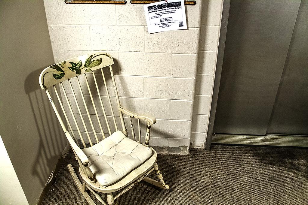 Rocking chair by elevator--Queen Village